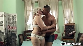 Granny Norma takes youthful boy's hard knob