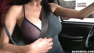 Car fun with a really huge-boobed mama and her guy